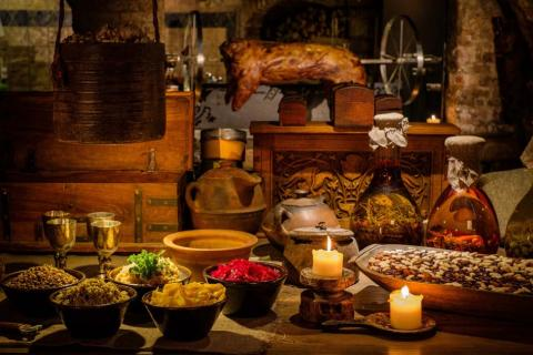Medieval ancient kitchen table with typical food in wealthy home. (Nejron Photo/Adobe Stock)